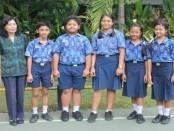 Para peneliti muda SMP Negeri 10 Denpasar usai mengharumkan nama sekolah di ajang Lomba Penelitian Siswa Nasional (LPSN) - foto: Koranjuri.com