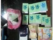 Sejumlah barang bukti hasil perjudian berupa uang dan kupon judi yang diamankan - foto: Sujono/Koranjuri.com