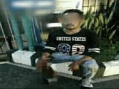 Rahmat Taufik, pelaku usai menyerahkan diri ke polisi - foto: Istimewa