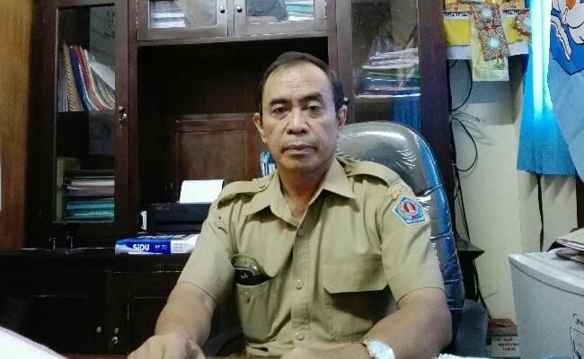 Kepala SMP Negeri 11 Denpasar I Putu Jaya - foto: Koranjuri.com