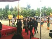 Presiden Jokowi tiba di Lapangan Puputan Renon untuk menyerahkan sertifikat prona - foto: Istimewa