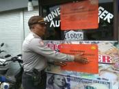 Gerai money changer tak berijin di wilayah Kuta dan Seminyak disegel aparat, Kamis, 25 Januari 2018 - foto: Istimewa
