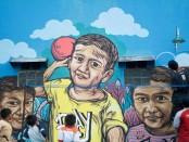 Hasil karya mural sekelompok mahasiswa yang tergabung dalam Posko program KKN Universitas Sebelas Maret (UNS) - foto: Meddia/Koranjuri.com