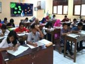 Suasana try out Ujian Nasional SD di SMPN 4 Purworejo, Minggu (11/3) - foto: Sujono/Istimewa