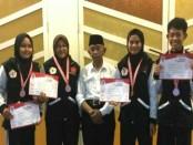 Empat pesilat dari SMK Kesehatan Purworejo, peraih medali perunggu dalam kejuaraan pencak silat Yogyakarta Championship 3 2018 - foto: Sujono/Koranjuri.com