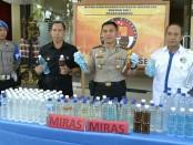 Ratusan liter miras ilegal yang diamankan Polres Badung - foto: Istimewa