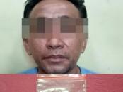 Subnit Narkoba Polsek Tambora Polres Metro Jakarta Barat menangkap SU (30) tukang Ojek Online lantaran kedapatan miliki narkoba jenis sabu - foto: Istimewa