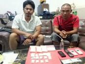 Dua pengedar narkoba yang diamankan Tim Direktorat Narkoba Polda Bali bersama Satgas Counter Transnational Organized Crime (CTOC) di Kubutambahan, Buleleng - foto: Istimewa