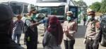 Pemudik Berdatangan, Satlantas Polres Purworejo Sterilkan Bus dan Penumpang