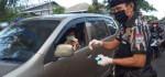 Pekat Indonesia Bersatu Bagikan Hand Sanitizer Gratis kepada Pengguna Jalan