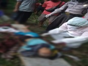 Petugas medis ber-APD lengkap saat memeriksa jenazah korban, I Made Tekes (70) yang jatuh ke dalam jurang sedalam 20 meter di Desa Kenderan Tegallalang, Sabtu (13/6/2020) kemarin - foto: Catur/Koranjuri.com
