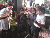 Paket AMERTA paslon nomer urut 2 dalam Pilkada Kota Denpasar berdialog dengan pedagang di Pasar Satria, Denpasar, Selasa, 20 Oktober 2020 - foto: Istimewa