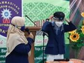Karya inovasi siswa SMP Muhammadiyah PK Kota Barat, Surakarta berupa smart face shield yang di lengkapi dengan alat pengukur suhu tubuh otomatis - foto : Istimewa
