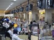 Pelayanan penumpang di Bandara Internasional I Gusti Ngurah Rai Bali saat PPKM Darurat Jawa-Bali - foto: Istimewa