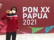 Anny Pandini sumbang emas pertama tim Judo Bali di PON XX Papua - foto: Yan Daulaka/Koranjuri.com