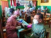 Pelaksanaan vaksinasi dosis kedua di SMK TKM Purworejo, Kamis (21/10/2021), bekerjasama dengan Kodim 0708 Purworejo - foto: Sujono/Koranjuri.com