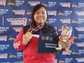 Petembak putri andalan Bali Lily Sulistyadewi Tirthajaya akhirnya sukses merebut emas nomor air pistol perorangan 10 meter - Yan Daulaka/Koranjuri.com