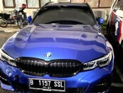 Mobil BMW yang pengemudinya kini menjalani pemeriksaan polisi terkait insiden di Jalan Sisingamangaraja, Jakarta Utara - foto: Istimewa