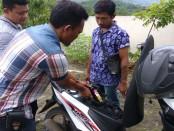 Sdm, diamankan karena bawa miras di jok motor – foto: Sujono/Koranjuri.com