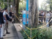 Kran Air Siap Minum milik PDAM Kota Denpasar di Lapangan Puputan Badung diberi garis polisi - foto: Istimewa