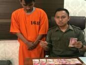 Pelaku bernama Mohammad Desi Andrian (24) asal Jember, Jawa Timur. Peristiwa itu terjadi di Indomaret Jalan Tangkuban Perahu, Denpasar pada Minggu (30/7/2017) - foto: Istimewa