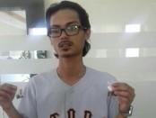 Pemuda bernama Mohamad Azzren Bin Mohd. Arip alias MABMA warga Malaysia (28), diketahui membawa narkoba jenis ganja yang sudah dikemas menjadi dua linting - foto: Istimewa