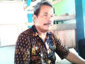 Suhasti, SH, Kasi Tata Pemerintahan, yang juga Sekertaris Tim Pengawas dan Fasilitasi Pengisian Perangkat Desa Kecamatan Ngombol - foto: Sujono/Koranjuri.com