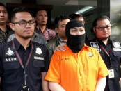 Polda Metro Jaya menangkap Arseto Suryoadji (36) terkait postingan di akun facebook kalimat mengandung ujaran kebencian - foto: Bob/Koranjuri.com