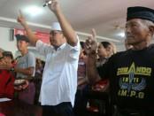 Sosok pria bernama M. Thoyib itu mengenakan kaus bertuliskan 'Comando Inti AMPG' - foto: Istimewa