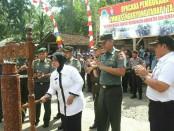Wakil Bupati Purworejo, Yuli Hastuti, saat membuka TMMD Sengkuyung Tahap I Tahun 2018 Kodim 0708 Purworejo, Rabu (4/4), di Desa Cacaban Kidul, Bener - foto: Sujono/Koranjuri.com