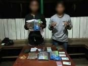 Dua pelaku pengedar ganja di perbatasan RI-PNG diamankan Satgas Yonif PR 501/Kostrad - foto: Istimewa