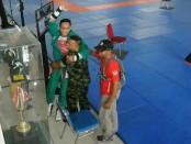 Atlet Yongmoodo Pratu I Wayan Supriana dari Satuan Yonif Raider 900/Satya Bhakti Wirottama Kodam IX/Udayana berhasil membawa medali emas di kelas -70 Kg Kejurnas Yongmoodo Kasad Cup Ke-8 di Bali - foto: Istimewa