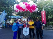 Pembukaan jalan sehat yang diinisiasi oleh produsen minuman Coolant dalam memeriahkan HUT Kota Denpasar di Lapangan Lumintang, Denpasar - foto: Koranjuri.com