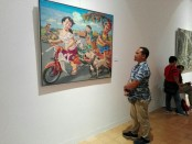 Karya Karikatural Faizin, seorang pelukis asal Banyuwangi di Pameran lukisan berjudul 'Connectedness' di Santrian Gallery Sanur - foto: Koranjuri.com