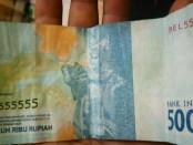 Pecahan rupiah Rp 50.000 ini memiliki nomer seri cantik BEL555555 - foto: Istimewa