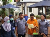 Ditresnarkoba Polda Metro Jaya memusnahkan barang bukti narkoba jenis heroin, Kamis (21/11/2019) - foto: Bob/Koranjuri.com