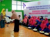 Suasana penerimaan raport siswa Boarding School SMK Kesehatan Purworejo, Rabu (18/12) - foto: Sujono/Koranjuri.com
