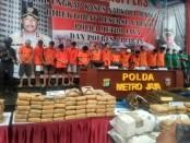 Barang bukti ganja seberat 1,4 ton yang diamankan dari 19 tersangka sindikat peredaran narkoba jenis ganja, dirilis Polda Metro Jaya, Rabu, 22 Januari 2020 - foto: Bob/Koranjuri.com