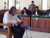 Terdakwa Harijanto Karjadi saat sidang di PN Denpasar - foto: Koranjuri.com