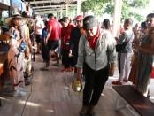 Penyemprotan Disinfektan - Wisatawan di Bali beraktifitas normal di tengah isu merebaknya virus corona covid-19 - foto: Istimewa