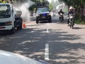 Jalan-jalan utama di Kota Purworejo, jadi sasaran penyemprotan disinfektan massal, Selasa (31/3/2020) - foto: Sujono/Koranjuri.com