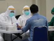 Pekerja migran Indonesia asal Bali menjalani sejumlah proses screening di Bandara Ngurah Rai Bali, untuk memastikan kondisi kesehatan mereka - foto: Istimewa