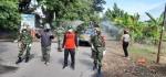 Ikhtiar Warga Lakukan Disinfeksi Jalan Protokol di Kelurahan Purworejo