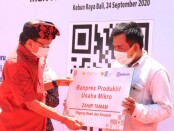 Gubernur Bali Wayan Koster meresmikan portal belanja pasar tradisional pasar.id yang dirilis BRI Kanwil Denpasar bersama Bank Indonesia. Peresmian dilakukan di Kebun Raya Bali, Kamis, 24 September 2020 - foto: Istimewa