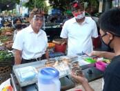 Pasangan Calon (Paslon) Nomor Urut 2 Gede Ngurah Ambara Putra dan Made Bagus Kertanegara (AMERTA) melakukan Grebek Pasar, berlokasi di Pasar Kreneng, Denpasar Timur Senin, 26 Oktober 2020 - foto: Istimewa