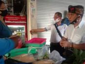 Paket AMERTA, paslon nomor urut 2 di Pilkada Kota Denpasar mengunjungi Pasar Anyar Peguyangan untuk menyerap aspirasi para pedagang di Pasar Tradisional - foto: Istimewa