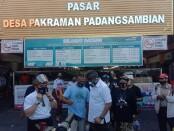Paslon Nomor Urut 2 Gede Ngurah Ambara Putra dan Made Bagus Kertha Negara (AMERTA) ketika melakukan blusukan di Pasar Tradisional Desa Pakraman Padangsambian, Denpasar, Jumat, 6 November 2020 - foto: Istimewa