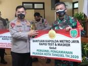 5.000 alat rapid test dan 10.000 masker untuk penyelenggaraan pemilu aman dan sehat - foto: Istimewa