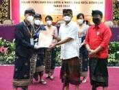 KPU Kota Denpasar melaksanakan tahapan penetapan paslon terpilih Sabtu (23/1/2021) di Hotel Inna Grand Bali Beach Sanur, sebagaimana rangkaian pelaksanaan tahapan Pilwali Kota Denpasar bersama dengan 269 Daerah Provinsi dan Kab/ Kota se-Indonesia pada Pilkada serentak 2020 - foto: Istimewa