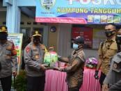 Kapolda Metro Jaya Irjen Fadil Imran mengunjungi Kampung Tangguh Jaya di kawasan Jalan Palem, Beji, Kota Depok, Jawa Barat - foto: Istimewa